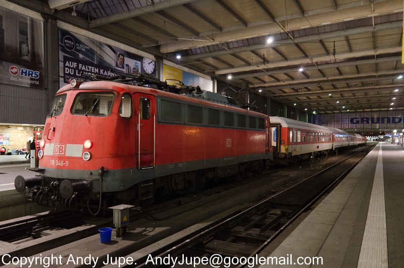 115 346-9 sits at München Hbf, Germany after hauling in the stock for CNL 485 (Munich- Rome) overnight sleeper service on the 6th of October 2014